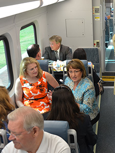 Mayor Teresa Jacobs sitting while on a Sunrail train