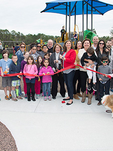 Mayor Jacobs and community memebers at a ribbon-cutting ceremony